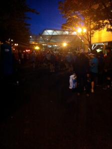 Lots of runners, supporters, and Port-A-Potties in Corral E