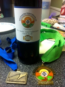 On the left, our finisher medal for completing the Leavenworth Race Series that started in Aug 2012. The wine was for 3rd place in my age group. And then the colorful finisher medal for the half marathon on the right.