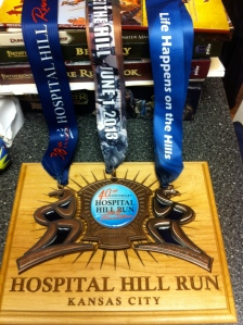 The finisher medals from the past 3 years for the Hospital Hill Half Marathon fit together like a puzzle. 2013's medal was the final piece.