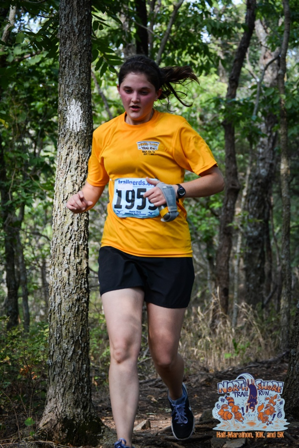 I don't know who she is, but she's doing a lovely job modeling good running form and the official race shirt. It had the cool race logo (in the bottom right corner) on the back.