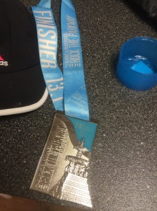 """Cuz I walk with a limp like an ol' school pimp, a real OG"" Wait, not really. It's because we just finished a half marathon and are hobbling around with these giant finisher medals around our necks. This thing is wider but slightly shorter than my iPhone 5."